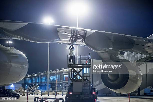 Ground crew member refuelling A380 aircraft at night