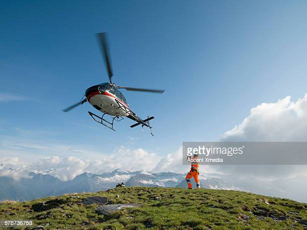 Ground crew member takes pic of departing copter