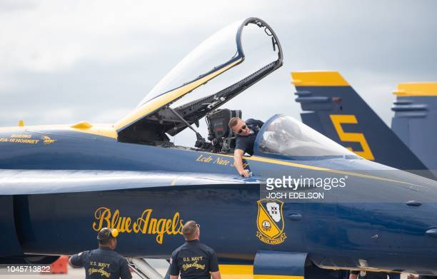 Ground crew members of the US Navy Blue Angels prepare a plane before a practice run for Fleet Week in Oakland California on October 4 2018
