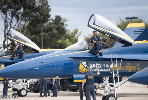 Ground crew members of the US Navy Blue Angels prepare planes before a practice run for Fleet Week in Oakland California on October 04 2018