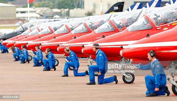 Ground Crew of the RAF Aerobatic Team The Red Arrows seen alongside the Red Arrows Hawk Jets at the Royal International Air Tattoo at RAF Fairford on...