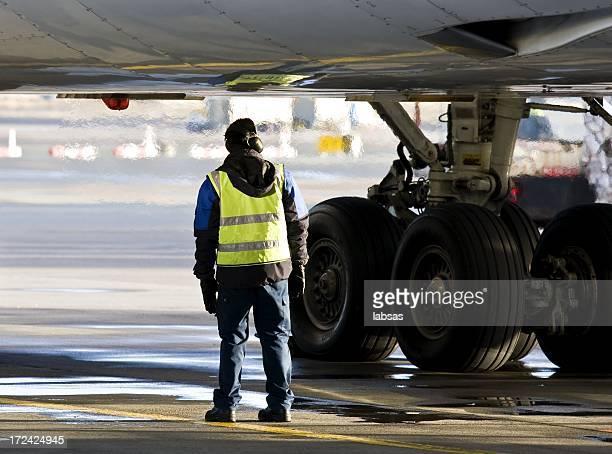 Ground crew preparing big jet for take off