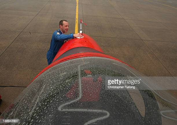 Ground crew Sergeant Tim Elton cleans the fuselage of Red 5 as The Red Arrows prepare to practise their 2012 air display at RAF Scampton on June 22...