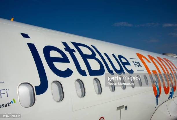 Ground crew staff observe an arriving JetBlue Airways plane from New York City at the Maurice Bishop International Airport in St Georges Grenada...