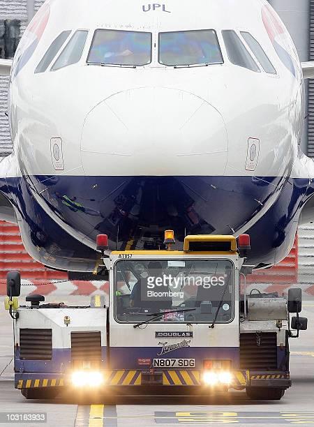 A ground crew worker prepares a British Airways aircraft at Heathrow airport in London UK on Thursday July 29 2010 British Airways Plc said its...