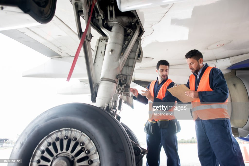 Ground crew working at the airport : Stock Photo