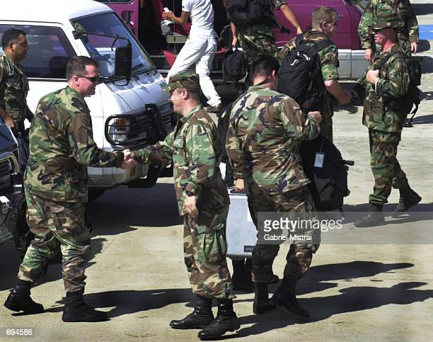 S ground crews greet fellow soldiers after landing January 25 2002 at Zamboangas airport in Zamboanga City southern Philippines The US soldiers will...