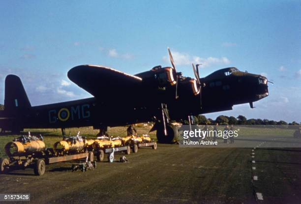 Ground crews loading bombs onto a Short Stirling bomber, circa 1943.