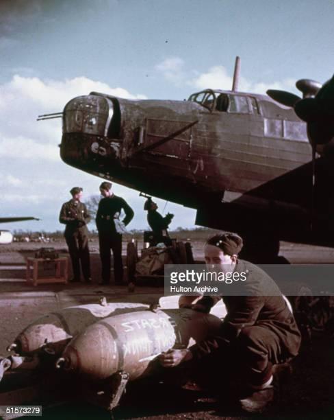 Ground crews loading bombs onto a Vickers Wellington bomber, circa 1943.