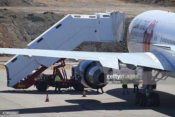 Ground crews prepare the Aeronexus Corporation's Boeing 767 used by the Rolling Stones in readiness for takeoff at Perth international airport on...
