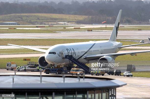 Ground crews remove an emergency escape chute after a Pakistan Airlines plane was evacuated following a fire at Manchester Airport, 01 March 2005....
