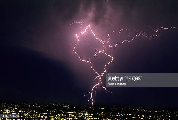 Ground discharge and cloud discharge lightning over city illustrating lightning channel tortuosity Tucson Arizona USA