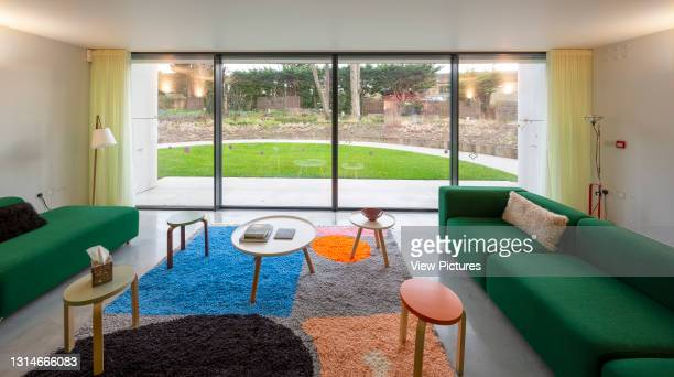 Ground floor seating area with view to garden. Maggie's Centre, Royal Marsden Hospital, Sutton, United Kingdom. Architect: Ab Rogers Design, 2019.