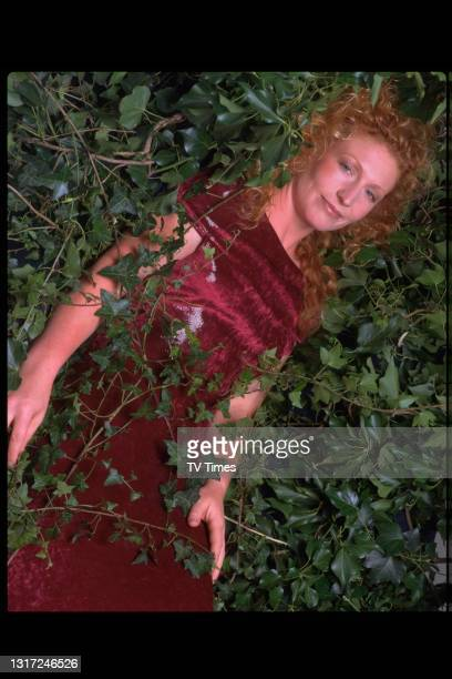 Ground Force presenter and gardening expert Charlie Dimmock posed in foliage, circa 1998.