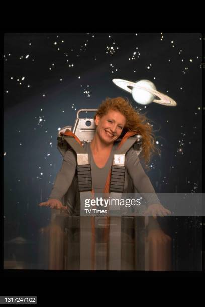 Ground Force presenter and gardening expert Charlie Dimmock wearing a spacesuit against a starry background, circa 1998.