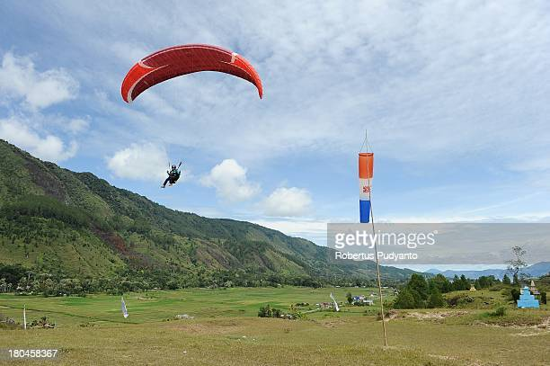 Ground landing paragliding athletes in action during the competition as part of Lake Toba Festival 2013 on September 13 2013 in Medan Sumatra...