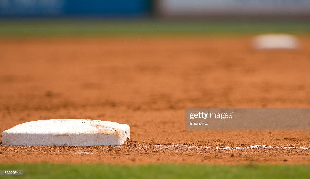 Ground level view of a base on the baseball field : Stock Photo
