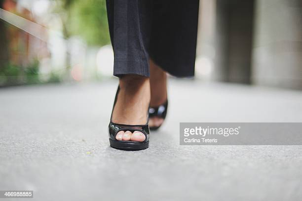 Ground level view of a woman walking in heels