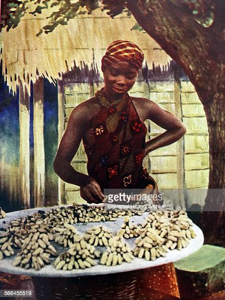 Ground nuts are the neatly piled wares of this Gold Coast girl at Accra ghana The oil crushed from this nut is sold as groundnut oil 1948