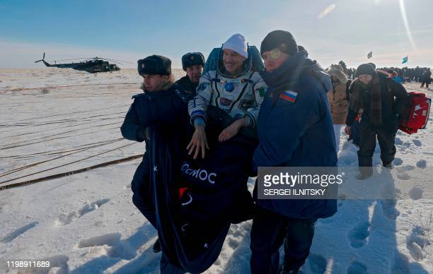 Ground personnel carry Luca Parmitano of the European Space Agency shortly after landing in a remote area outside the town of Dzhezkazgan Kazakhstan...