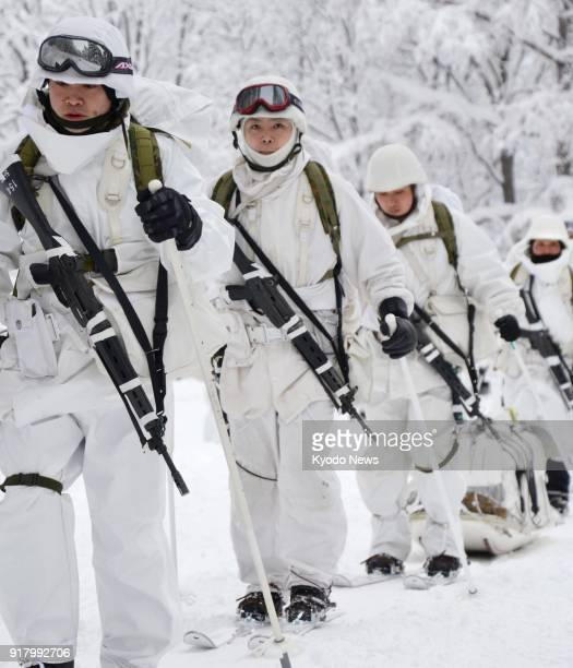 A Ground SelfDefense Force unit conducts an annual skiing drill at the Hakkoda Mountains in Aomori in northeastern Japan on Feb 14 to maintain the...