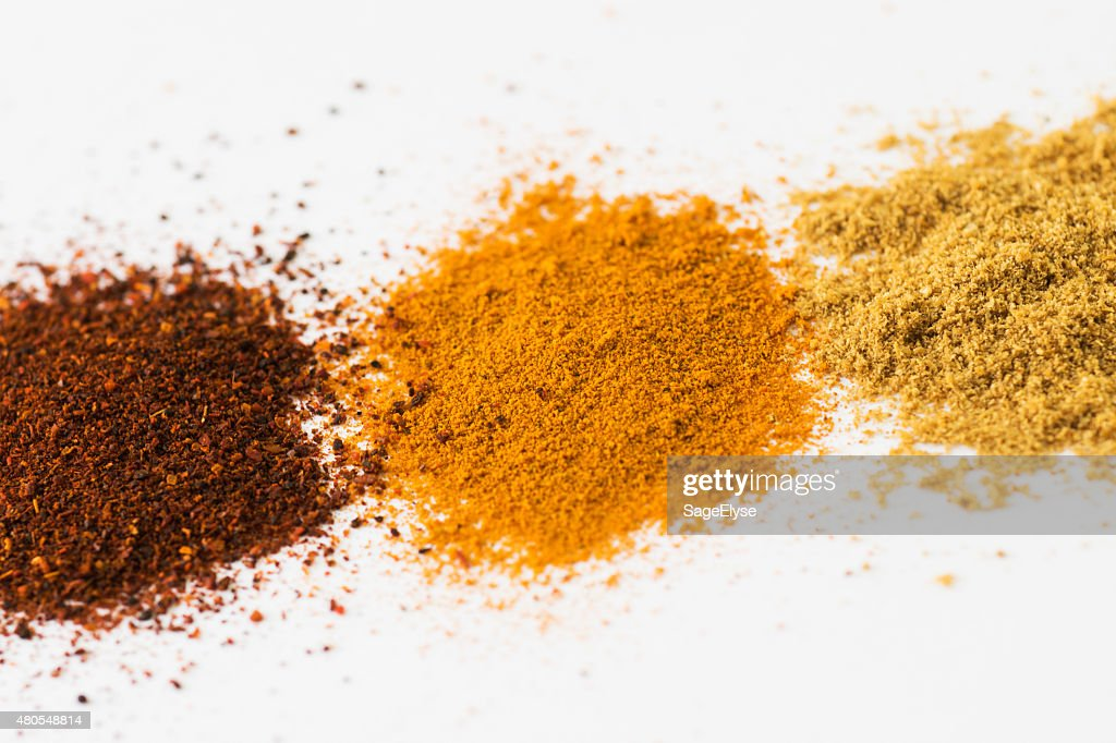 ground spices chili powder turmeric coriander on white background : Stock Photo