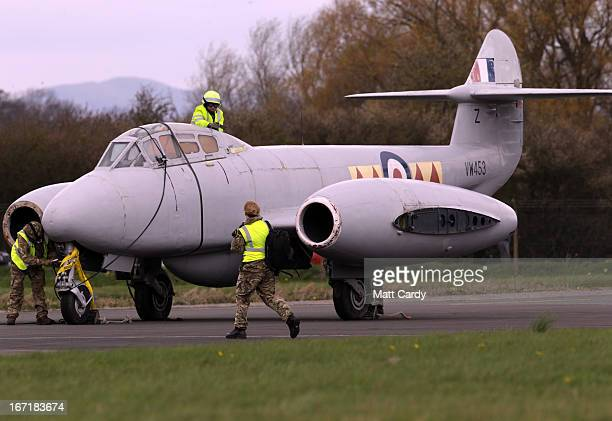 Ground staff attend to a Gloster Meteor T7 jet after it was moved to its new home at the Jet Age Museum which is based at Gloucestershire Airport in...