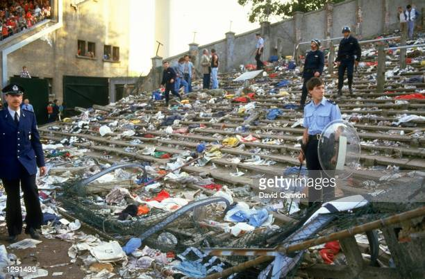 Ground staff clear the aftermath of the Heysel disaster after the European Cup Final between Liverpool and Juventus at the Heysel Stadium in...