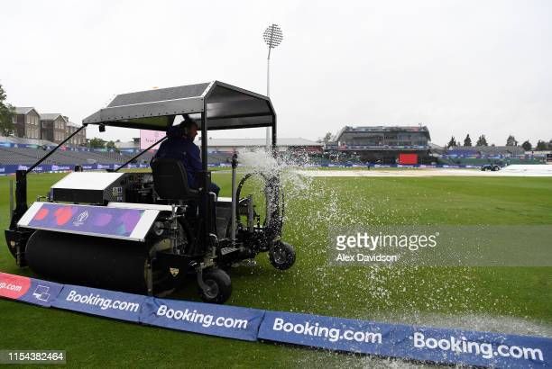 Ground staff clear water from the pitch during the Group Stage match of the ICC Cricket World Cup 2019 between Pakistan and Sri Lanka at Bristol...