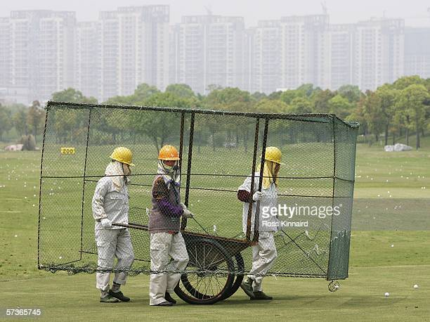 Ground staff collect balls on the driving range during the proam event prior to the BMW Asian Open at the Tomson Golf Club on April 192006 in...