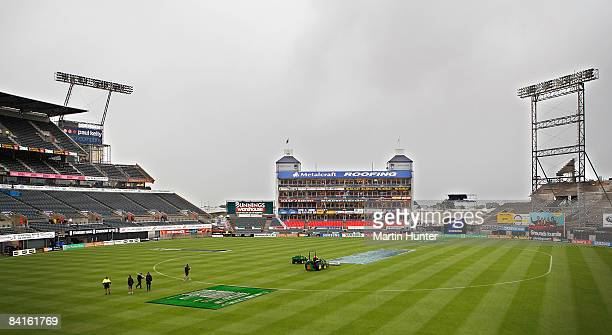Ground staff cover the pitch as bad weather hit the second One Day International match between the New Zealand Black Caps and the West Indies at AMI...