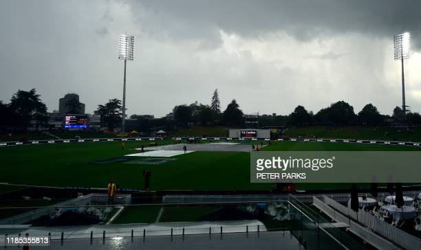 Ground staff cover the pitch as the game is abandoned due to a storm during the first day of the second cricket Test between England and New Zealand...