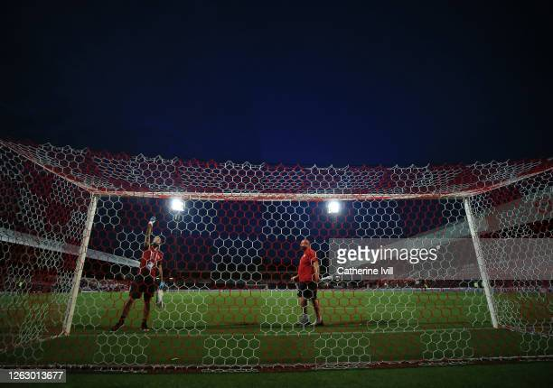 Ground staff disinfect the goalposts during the Sky Bet Championship Play Off Semifinal 2nd Leg match between Brentford and Swansea City at Griffin...
