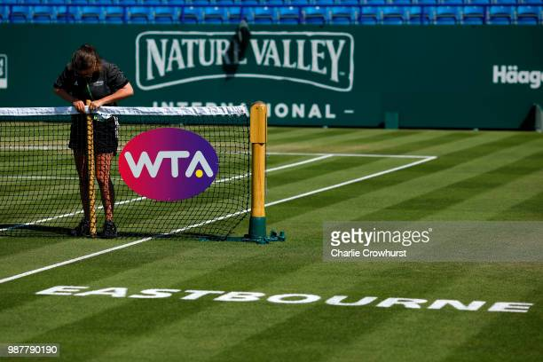 Ground staff fix up the net during Day Nine of the Nature Valley International at Devonshire Park on June 30 2018 in Eastbourne United Kingdom