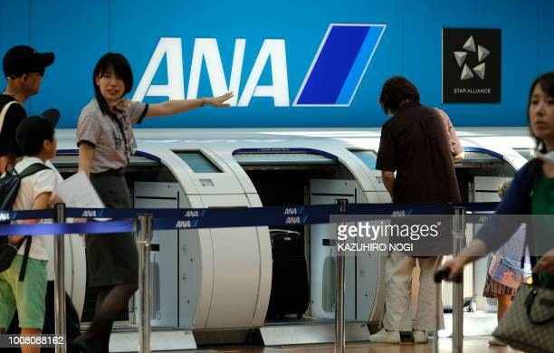 Ground staff for All Nippon Airways work at the departure floor of Tokyo's Haneda airport on July 31 2018 Major Japanese carriers All Nippon Airways...