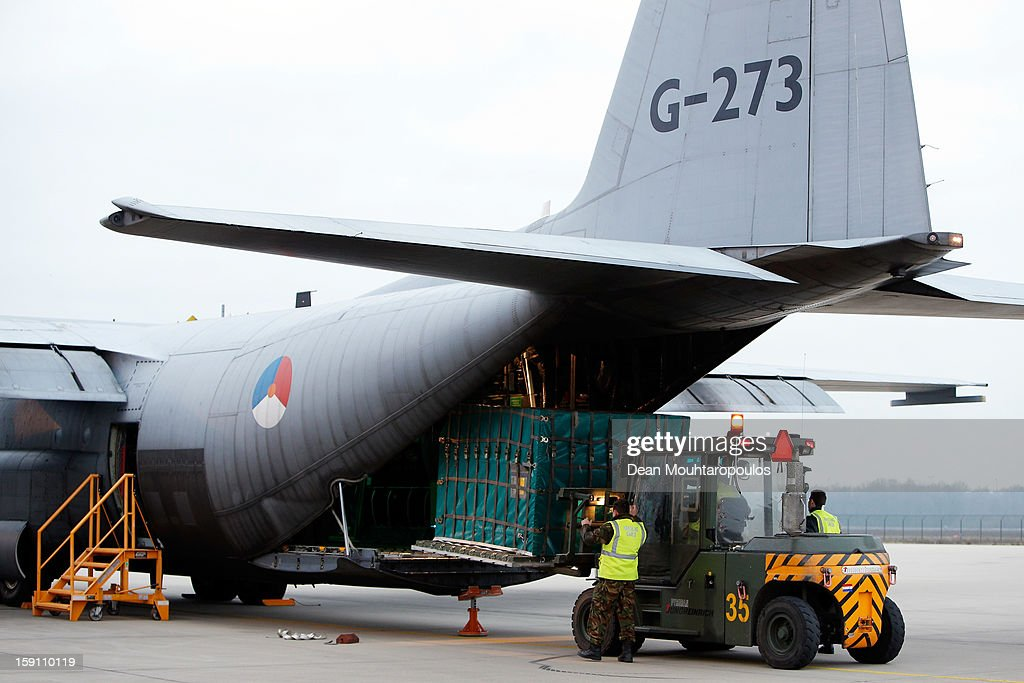 Ground staff get the C-130 Hercules aeroplane ready for soldiers from the Netherlands and Germany to travel to Turkey from Eindhoven Military Airport on January 8, 2013 in Eindhoven, Netherlands. This advance party of Dutch and German troops will fly to Turkey to prepare for the arrival of the Patriots with the main body of European soldiers arriving later in the month.