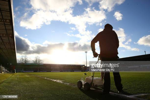 Ground staff is seen preparing the pitch ahead of The Emirates FA Cup Fourth Round match between Cheltenham Town and Manchester City at Jonny Rocks...