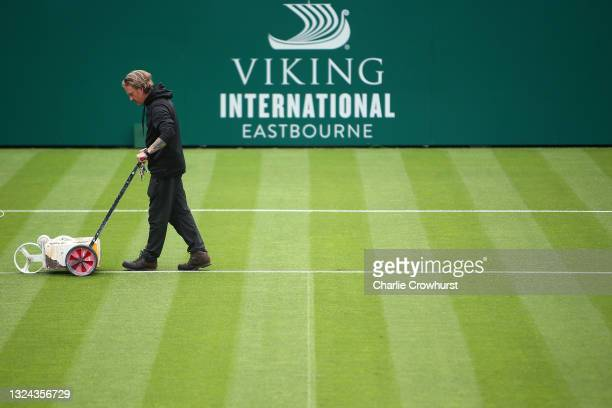 Ground staff prepare centre court ahead of play during day 1 of the Viking International Eastbourne at Devonshire Park on June 19, 2021 in...