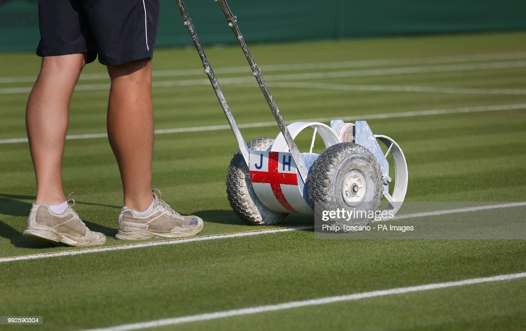 Ground staff prepare the courts on day five of the Wimbledon Championships at the All England Lawn Tennis and Croquet Club, Wimbledon.