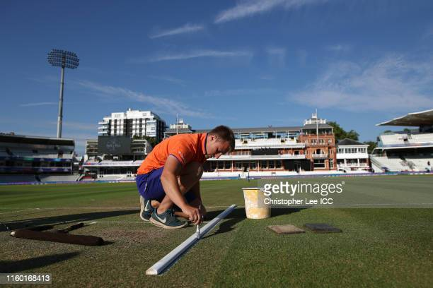 Ground staff prepare the wicket during the Group Stage match of the ICC Cricket World Cup 2019 between Pakistan and Bangladesh at Lords on July 05,...