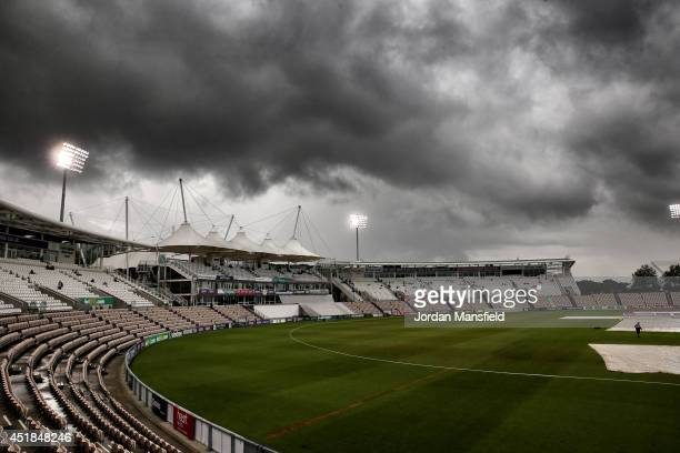 Ground staff pull the covers on as play is delayed due to rain on day two of the LV County Championship match between Hampshire and Gloucestershire...