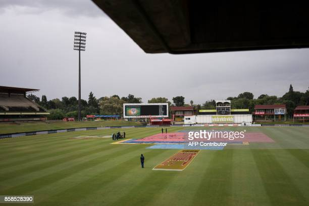 Ground staff stand at the centre of the oval as rain falls during the second day of the second Test Match between South Africa and Bangladesh in...