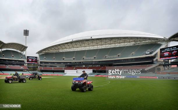 Ground staff use a blower and tow ropes to get the field ready for play during the Sheffield Shield match between South Australia and New South Wales...
