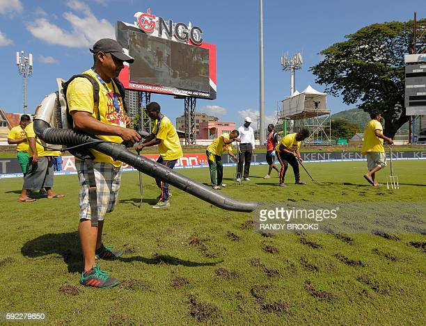 Ground staff use a blower to dry the field under the supervision of umpire Gregory Brathwaite during day 3 of the 4th and final Test between West...