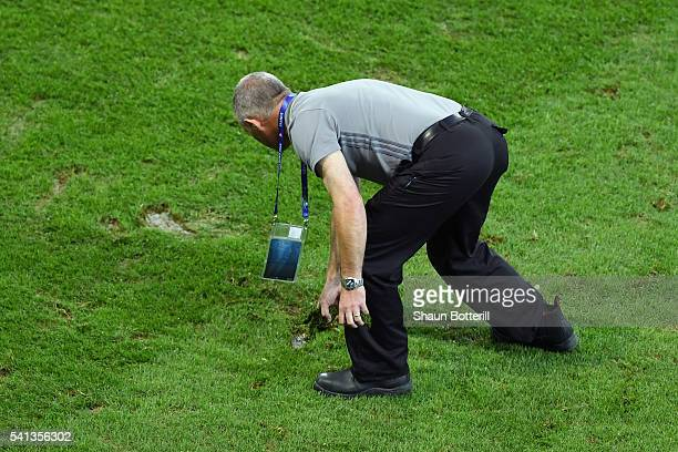 Ground staffs tend the pitch at the half time during the UEFA EURO 2016 Group A match between Switzerland and France at Stade PierreMauroy on June 19...