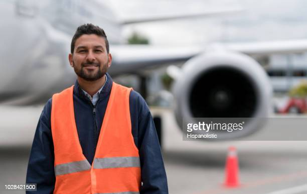 ground technician working at the airport - waistcoat stock photos and pictures