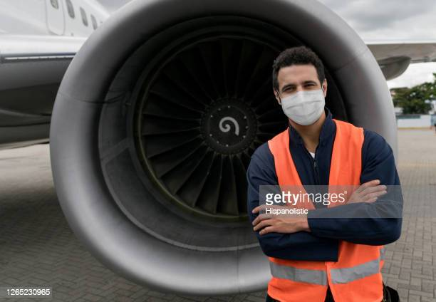ground technician working at the airport wearing a facemask - biosecurity stock pictures, royalty-free photos & images