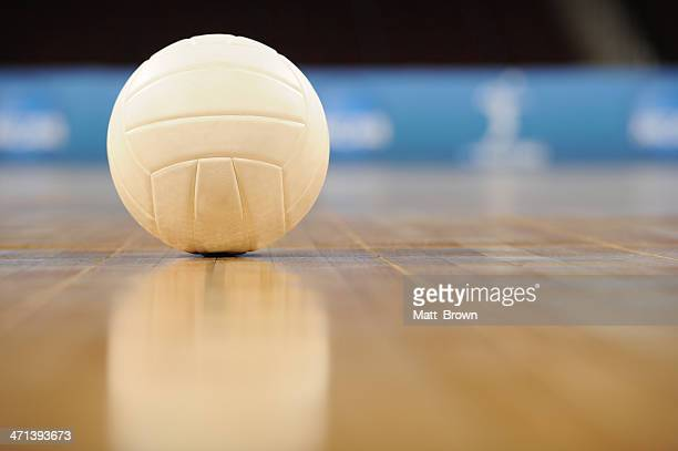 Ground view of a volleyball on the floor in an empty gym