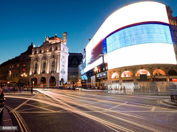 a ground view of piccadilly circus - piccadilly stock pictures, royalty-free photos & images