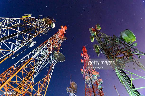 ground view of telecommunication towers - telecommunications equipment stock pictures, royalty-free photos & images